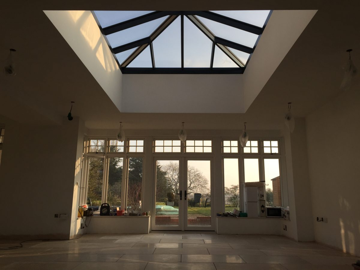 Lantern rooflight, French doors and limestone floor – all set out, bang on the centre line!